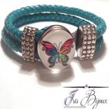bratara-piele-naturala-impletita-turquoise-si-buton-interschimbabil-cu-fluture-multicolor